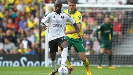 Christoph Zimmermann tries to wrestle Sone Aluko at Craven Cottage. Picture by Paul Chesterton/Focus