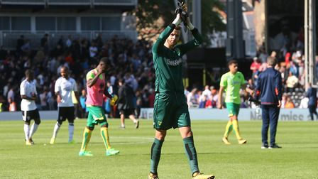Angus Gunn salutes the travelling support at Craven Cottage. Picture: Paul Chesterton/Focus Images L