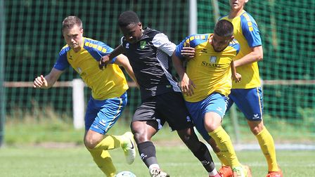 Diallang Jaiyesimi in action for Norwich City U23s during a pre-season friendly against Eintracht Br