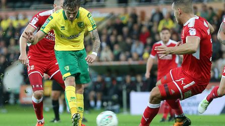 James Maddison of Norwich scores his side's third goal during the Carabao Cup match against Swindon