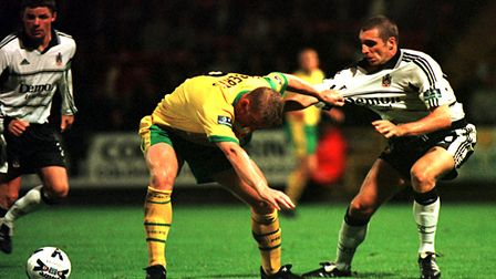 Iwan Roberts involved in a tussle against Fulham - how will the 2017-18 Norwich City fare this weeke