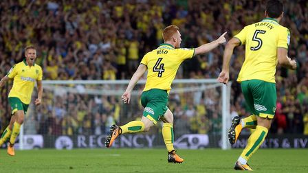 Harrison Reed of Norwich celebrates scoring his side's second goal during the Sky Bet Championship m