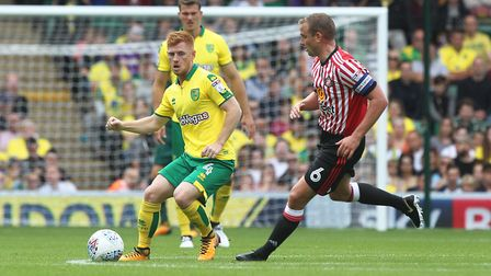 Harrison Reed battles with Lee Cattermole during Norwich City's sobering defeat to Sunderland at Car