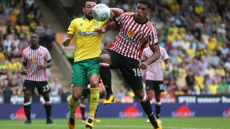 Russell Martin and Tyias Browning clash at Carrow Road. Picture: Paul Chesterton/Focus Images