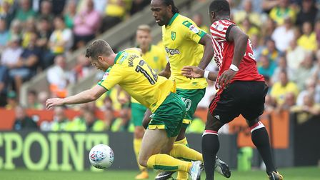 Marley Watkins hits the deck after being fouled by Lamine Kone. Picture: Paul Chesterton/Focus Image