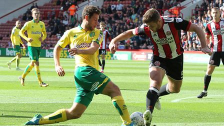 Yanic Wildschut of Norwich City and Jack O'Connell of Sheffield United in action during the Sky Bet