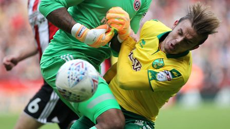 James Maddison of Norwich City clashes with Sheffield United goal keeper Jamal Blackman during the S