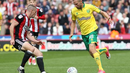 Paul Coutts of Sheffield United and Marco Stiepermann of Norwich City in action during the Sky Bet C
