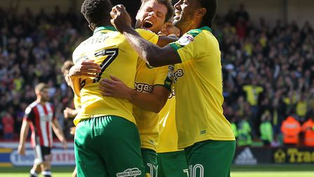 Yanic Wildschut celebrates with his team-mates after scoring what proved to be Norwich City's winner