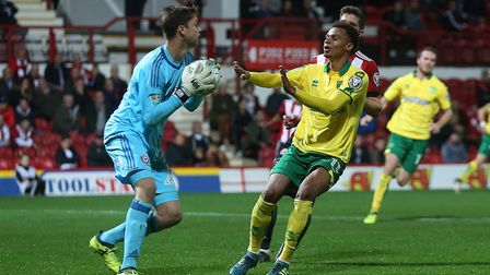Luke Daniels of Brentford collects the ball safely ahead of Josh Murphy of Norwich during the Caraba