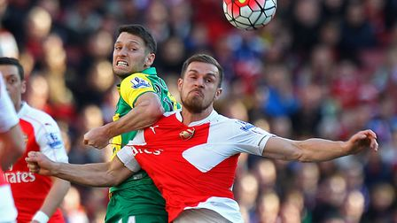 Wes Hoolahan battles with Aaron Ramsey during Norwich City's 1-0 Premier League defeat at Arsenal in