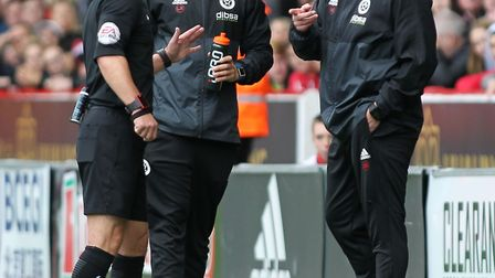 Chris Wilder loves a moan - here he gets his marching orders from referee Scott Duncan. Picture: Mic