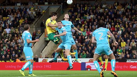 Timm Klose heads on goal against Burton at Carrow Road. Picture by Paul Chesterton/Focus Images
