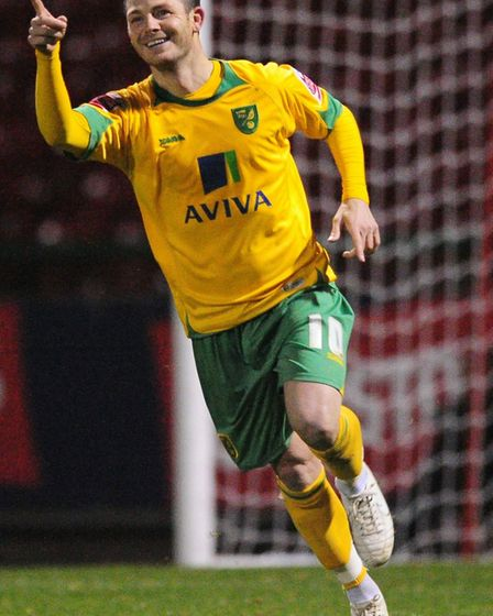 Jamie Cureton celebrates his final goal in his final appearance for the Canaries - a Johnstones Pain