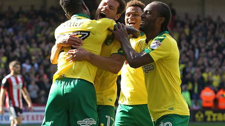 Yanic Wildschut of Norwich City celebrates with his team mates after scoring the first goal against