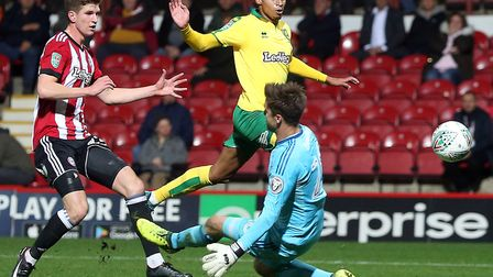 Josh Murphy lifts the ball over Brentford keeper Luke Daniels to put City 3-0 ahead. Picture: Paul C