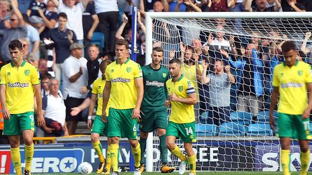 The Norwich players look dejected after conceding their sides fourth goal during the Sky Bet Champio