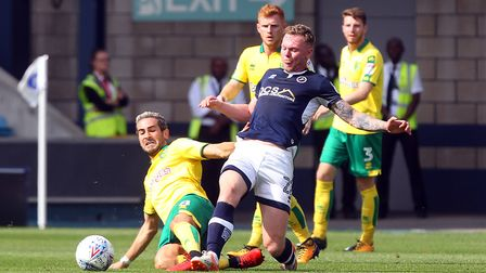 James Husband (3) watches on as Mario Vrancic slides in on Millwall's Aiden O'Brien. Picture: Paul C