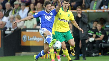 Jason Lowe of Birmingham City and Nelson Oliveira of Norwich in action during the Sky Bet Championsh
