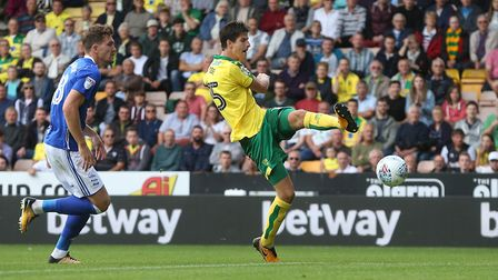 Timm Klose tees up Nelson Oliveira for Norwich City's early winner over Birmingham. Picture: Paul Ch
