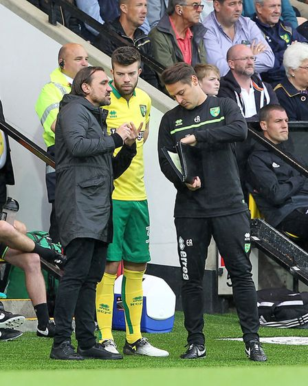 Daniel Farke gives instructions to Grant Hanley ahead of his late debut cameo. Picture: Paul Chester