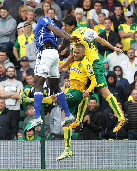 Timm Klose and Tom Trybull battle for the same ball during a dogged performance at Carrow Road. Pict