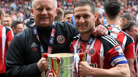 Prolific striker Billy Sharp, right, pictured with Sheffield United boss Chris Wilder and the League