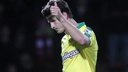 Timm Klose give the thumbs up to the travelling Canaries fans as he is substituted at Brentford. Pic