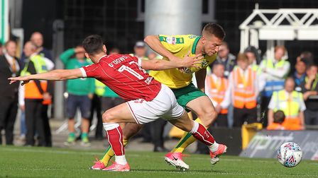 Callum O'Dowda of Bristol City and Marco Stiepermann of Norwich in action during the Sky Bet Champio