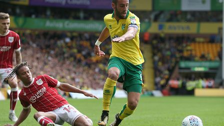 Norwich skipper Ivo Pinto gets away from Bobby Reid during the 0-0 draw with Bristol City at Carrow
