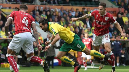 Norwich City midfielder Mario Vrancic is brought down by Josh Brownhill early in the second half of