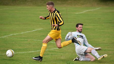 Beccles' Billy Shaw gets past the Acle goalkeeper to score the first goal. Picture: ANTONY KELLY