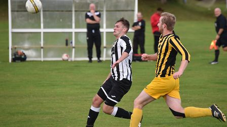 Eyes on the ball during the 3-3 draw between Acle and Beccles (yellow). Picture: ANTONY KELLY
