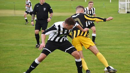 A battle for possession between Acle and Beccles (yellow).Picture: ANTONY KELLY