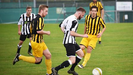 Action from the clash between Acle and Beccles (yellow). Picture: ANTONY KELLY