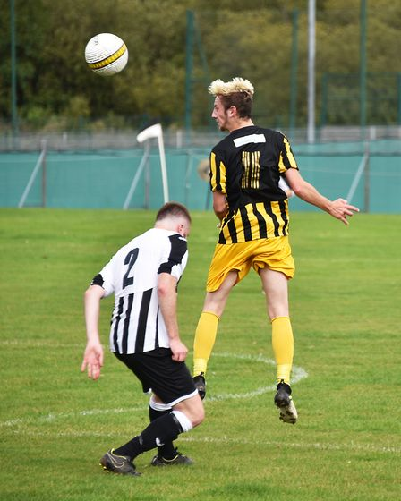 Aerial action during the 3-3 draw between Acle and Beccles (yellow). Picture: ANTONY KELLY