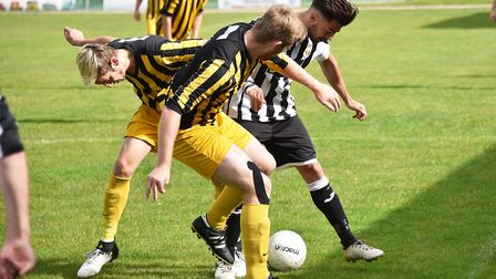 An Acle player is outnumbered during the draw with Beccles. Picture: ANTONY KELLY