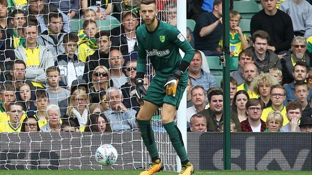 Angus Gunn is delighted to see Norwich City's defensive resolve has really clicked since August's in