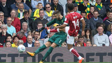Angus Gunn clears as Bobby Reid closes him down at Carrow Road. Picture: Paul Chesterton/Focus Image