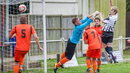 Ryan Pearson rises to head home the first for Swaffham Town. Picture: Eddie Deane