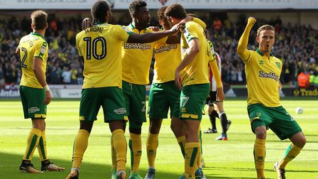 Yanic Wildschut is mobbed by his team mates after rifling Norwich City in front at Sheffield United.