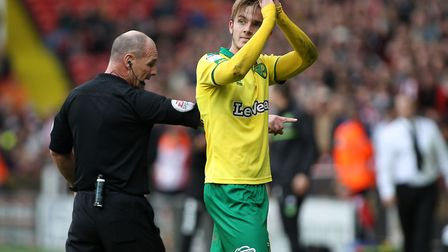 James Maddison is told to get off the pitch and stop time wasting by referee Scott Duncan, while app