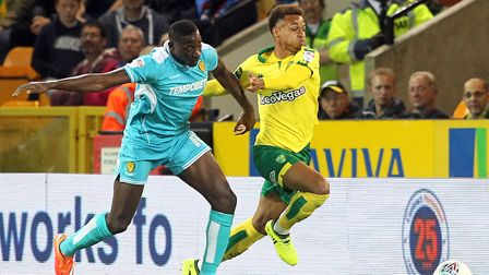 Josh Murphy tries to evade the attention of Burton's Lucas Akins on a frustrating night at Carrow Ro