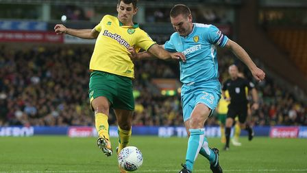Nelson Oliveira has Burton defender Jake Buxton for close attention.