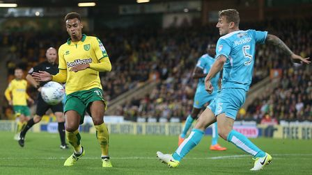 Kyle McFadzean of Burton Albion clears the ball ahead of Josh Murphy of Norwich during the Sky Bet C