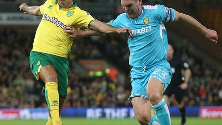 Nelson Oliveira of Norwich and Jake Buxton of Burton Albion in action during the Sky Bet Championshi