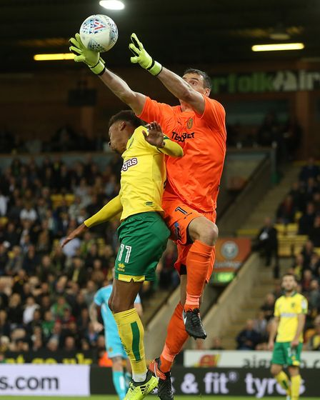 Stephen Bywater collects the ball safely ahead of Josh Murphy. It is unknown how long it then took t