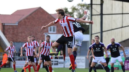 Sean Raggett (25) attacks an aerial ball in the Luton area. Picture by James Wilson/Focus Images