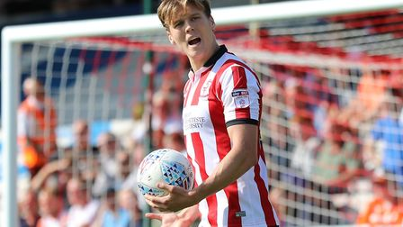 Sean Raggett in action during Lincoln City's 0-0 draw with Luton Town at Sincil Bank. Picture by Jam