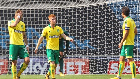 The Norwich players look dejected after conceding their sides third goal during the Sky Bet Champion